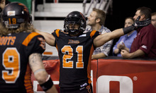Lennie Mahler  |  The Salt Lake Tribune Utah Blaze's Tysson Poots (left) and Shaun Kauleinamoku celebrate a touchdown against the San Antonio Talons on Saturday, May 26, 2012, at EnergySolutions Arena.