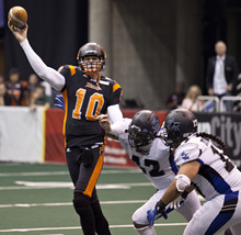 Lennie Mahler  |  The Salt Lake Tribune Utah Blaze QB Tommy Grady releases a pass against the San Antonio Talons on Saturday, May 26, 2012, at EnergySolutions Arena.