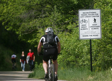 Kim Raff   The Salt Lake Tribune People walk and bike past one of the new signs on the City Creek Trail for bikers and pedestrians in Salt Lake City, Utah on May 25, 2012.