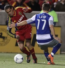 Rick Egan  | The Salt Lake Tribune   Real Salt Lake's Fabian Espindola (7), gets past Zach Lloyd (17) FC Dallas, in MLS soccer action, Real Salt Lake vs FC Dallas, in Sandy, Saturday, May 26, 2012.