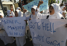 Muslim students shout slogans during a rally against U.S. pop singer Lady Gaga's concert that is scheduled to be held on June 3, outside the U.S. Embassy in Jakarta, Indonesia, Friday, May 25, 2012. Lady Gaga might have to cancel her sold-out show in Indonesia because police worry her sexy clothes and dance moves undermine Islamic values and will corrupt the country's youth. (AP Photo/Dita Alangkara)