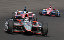 IndyCar driver JR Hildebrand leads fellow drivers Mike Conway, center, Graham Rahal through the first tun on the final day of practice for the Indianapolis 500 auto race at the Indianapolis Motor Speedway in Indianapolis, Friday, May 25, 2012. The 96th running of the race is Sunday. (AP Photo/AJ Mast)