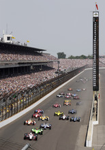 IndyCar driver Ryan Briscoe, of Australia, leads the field into the first turn on the start during of the Indianapolis 500 auto race at the Indianapolis Motor Speedway in Indianapolis, Sunday, May 27, 2012. (AP Photo/AJ Mast)