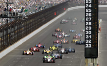 IndyCar driver Ryan Briscoe, of Australia, leads the field across the start/finish line on the start of the Indianapolis 500 auto race at the Indianapolis Motor Speedway in Indianapolis, Sunday, May 27, 2012. (AP Photo/AJ Mast)