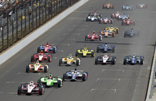 IndyCar driver Ryan Briscoe, of Australia, leads the field down the main straight on the start of the 96th Indianapolis 500 auto race at the Indianapolis Motor Speedway in Indianapolis, Sunday, May 27, 2012. (AP Photo/AJ Mast)
