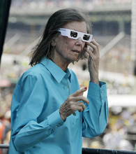 Mari Human George, chairman of the board of the Indianapolis Motor Speedway, wearing white sunglasses to honor Dan Wheldon, watches the start of the Indianapolis 500 auto race at the Indianapolis Motor Speedway in Indianapolis, Sunday, May 27, 2012. Wheldon, who won the 2011 Indianapolis 500, was killed in a fiery 15-car crash at Las Vegas Motor Speedway last October. (AP Photo/Michael Conroy)