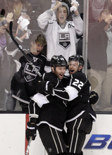 Los Angeles Kings left wing Dustin Penner, left, and teammate Trevor Lewis celebrate a goal by Penner during the third period of an NHL hockey game against the San Jose Sharks in Los Angeles, Tuesday, March 20, 2012. The Kings won 5-2. (AP Photo/Jae C. Hong)