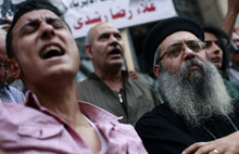 Egyptian Coptic Christians chant slogans at a protest calling for the release of Copts held in jails for political reasons, in downtown Cairo, Egypt, Sunday, May 27, 2012. (AP Photo/Fredrik Persson)