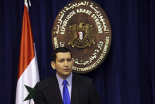Syria's foreign ministry spokesman Jihad Makdissi sparks at a news conference in Damascus, Syria, Sunday, May 27, 2012. Syria's foreign ministry spokesman has denied government troops were behind an attack on a string of villages that left more than 90 people dead. Friday's assault on Houla, an area northwest of the central city of Homs, was one of the bloodiest single events in Syria's 15-month-old uprising. Makdissi told reporters in Damascus at a Sunday news conference that Syria is being subjected to a