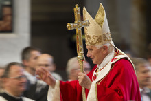 Pope Benedict XVI arrives to celebrate a Pentecost Mass inside St. Peter's Basilica, at the Vatican, Sunday, May 27, 2012. (AP Photo/Andrew Medichini)