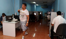Franklin Reyes  |  The Associated Press A man leaves a state-run computer center in Havana, Cuba in May. Cuban officials welcomed the arrival of an undersea fiber-optic cable linking the country to Venezuela, which was supposed to boost web capacity 3,000-fold. Even a retired Fidel Castro had hailed the dawn of a new cyber-age on the island. More than a year later, the government barely speaks of the cable anymore and Cuba's internet connection is still the slowest in the hemisphere.