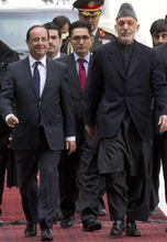 French President Francois Hollande, left, and Afghan President Hamid Karzai arrive for a press conference at the Presidential Palace in Kabul, Afghanistan, Friday, May 25, 2012.  Hollande announced that his country's troops had carried out their mission in Afghanistan and that it was time for them to leave, an early pullout that will be coordinated with the United States and other allies. (AP Photo/Anja Niedringhaus)