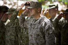 Gen. John Allen, center, the top U.S. commander in Afghanistan, salutes before he observes Memorial Day by reading a letter written by an American soldier to his family before he died earlier this year, at the ISAF headquarters in Kabul, Afghanistan, Monday, May 28, 2012. (AP Photo/Anja Niedringhaus)