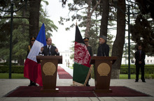 French President Francois Hollande, left, gestures during a joint press conference with Afghan President Hamid Karzai during his brief unannounced visit to Kabul, Afghanistan, Friday, May 25, 2012.  Hollande announced that his country's troops had carried out their mission in Afghanistan and that it was time for them to leave, an early pullout that will be coordinated with the United States and other allies. (AP Photo/Anja Niedringhaus)