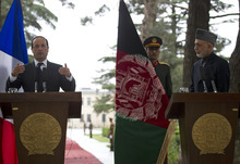 French President Francois Hollande, left, gestures during a joint press conference with Afghan President Hamid Karzai during his visit to Kabul, Afghanistan, Friday, May 25, 2012. France's new President Francois Hollande arrived early Friday in Afghanistan to meet with troops and the country's president and discuss plans for an early pullout. (AP Photo/Anja Niedringhaus)
