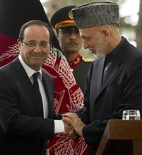 French President Francois Hollande, left, is greeted by Afghan President Hamid Karzai during his visit to Kabul, Afghanistan, Friday, May 25, 2012. France's new President Francois Hollande arrived early Friday in Afghanistan to meet with troops and the country's president and discuss plans for an early pullout. (AP Photo/Anja Niedringhaus)