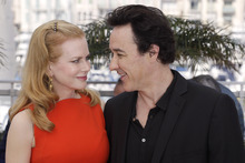 Actors Nicole Kidman, left, and John Cusack pose during a photo call for The Paperboy at the 65th international film festival, in Cannes, southern France, Thursday, May 24, 2012. (AP Photo/Lionel Cironneau)