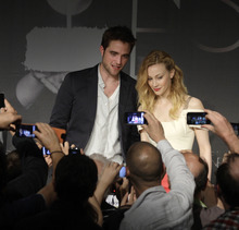 Actors Rob Pattinson, left, and Sarah Gadon during a press conference for Cosmopolis at the 65th international film festival, in Cannes, southern France, Friday, May 25, 2012. (AP Photo/Virginia Mayo)