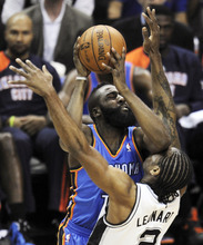 Oklahoma City Thunder guard James Harden (13) shoots over San Antonio Spurs small forward Kawhi Leonard (2) during the first half of Game 1 in their NBA basketball Western Conference finals playoff series, Sunday, May 27, 2012, in San Antonio. (AP Photo/Darren Abate)