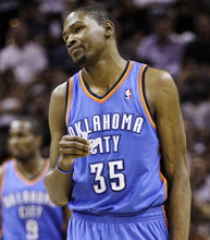 Oklahoma City Thunder small forward Kevin Durant reacts against the San Antonio Spurs during the first half of Game 1 in their NBA basketball Western Conference finals playoff series, Sunday, May 27, 2012, in San Antonio. (AP Photo/Eric Gay)