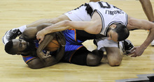 Oklahoma City Thunder's James Harden, left, and San Antonio Spurs' Manu Ginobili (20) grapple for a loose ball during the first half of Game 1 in their NBA basketball Western Conference finals playoff series on Sunday, May 27, 2012, in San Antonio. (AP Photo/Darren Abate)
