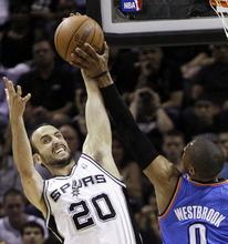 San Antonio Spurs shooting guard Manu Ginobili (20), of Argentina, blocks a shot by Oklahoma City Thunder point guard Russell Westbrook (0) during the first half of Game 1 in their NBA basketball Western Conference finals playoff series, Sunday, May 27, 2012, in San Antonio. (AP Photo/Eric Gay)