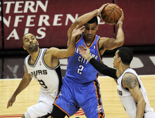 San Antonio Spurs' Tony Parker (9), of France, and Danny Green (4) defend against Oklahoma City Thunder shooting guard Thabo Sefolosha (2), of Switzerland, during the first quarter of Game 1 in their NBA basketball Western Conference finals playoff series, Sunday, May 27, 2012, in San Antonio. (AP Photo/Darren Abate)