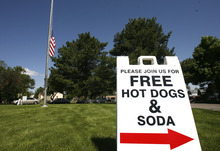 Rick Egan  | The Salt Lake Tribune   Free hot dogs and soda were served at the Valley View cemetery in West Valley, Monday, May 28, 2012. Valley VIew Cemetery offers free hot dogs and sodas to people visiting their family's graves, as well as face painting.