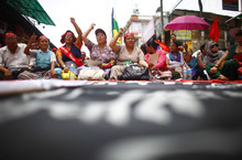 Members of the Nepal Federation of Indigenous Nationalities hold a demonstration near the Constitution Assembly building in Katmandu, Nepal, Saturday, May 26, 2012. They demanded that states proposed in the new constitution be determined on the basis of ethnic groups. (AP Photo/Niranjan Shrestha)