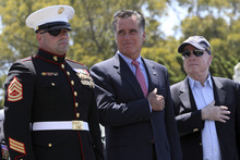 Republican presidential candidate, former Massachusetts Gov. Mitt Romney, center, Sen. John McCain, R-Ariz., right, and San Diego Veteran of the year Marine David Dickey stand together during a campaign stop at the Veterans Museum & Memorial Center, Monday, May 28, 2012 in San Diego.  (AP Photo/Mary Altaffer)