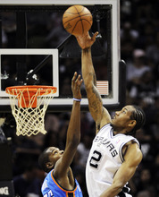 San Antonio Spurs forward Kawhi Leonard (2) blocks a shot by Oklahoma City Thunder forward Kevin Durant during the first half of Game 2 in their NBA basketball Western Conference finals playoff series, Tuesday, May 29, 2012, in San Antonio. (AP Photo/Darren Abate)