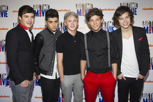 In this March 8, 2012 file photo, members of the band One Direction, from left, Liam Payne, Zayn Malik, Niall Horan, Louis Tomlinson and Harry Styles attend the premiere of the Nickelodeon TV movie