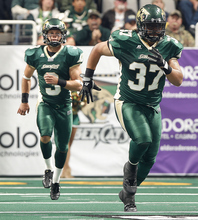 In this undated photo provided by the San Jose SaberCats, fullback Johnie Kirton (37) runs during an Arena Football League game in San Jose, Calif. Kirton died Monday, May 28, 2012, in Santa Clara, Calif., the team announced on Tuesday. He was 26. (AP Photo/San Jose SaberCats, Aric Crabb)  MANDATORY CREDIT