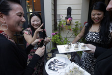 From left, Kathy Kuwaye, Minty O'Callaghan, and Tracy Lee enjoy foie gras-based appetizers at Sent Sovi Friday, May 11, 2012 in Saratoga, Calif. This is not a good time to be a duck in California. As a July 1 deadline looms for foie gras nears, renegade chefs across the state are loading their menus with the fatty duck liver and even holding secret dinners to avoid protesters, who say that force-feeding ducks is cruel. (AP Photo/Marcio Jose Sanchez)