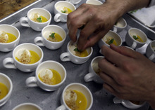 A carrot soup topped with foie gras cream is prepared at Sent Sovi Friday, May 11, 2012 in Saratoga, Calif. This is not a good time to be a duck in California. As a July 1 deadline looms for foie gras nears, renegade chefs across the state are loading their menus with the fatty duck liver and even holding secret dinners to avoid protesters, who say that force-feeding ducks is cruel. (AP Photo/Marcio Jose Sanchez)