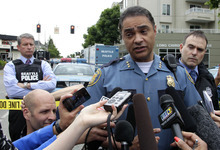 Seattle Police Deputy Chief Nick Metz talks to reporters near Cafe Racer, where a gunman opened fire, killing two people and critically wounded three others, Wednesday, May 30, 2012, in Seattle. Police are searching for the gunman, described as a man in his 30s wearing dark clothes. (AP Photo/Ted S. Warren)