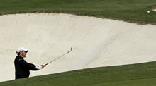 Mike Weir, of Canada, hits out of a bunker on the ninth hole during the second round the Masters golf tournament Friday, April 6, 2012, in Augusta, Ga. (AP Photo/Charlie Riedel)