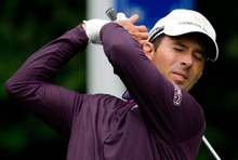 Canada's Mike Weir appears to wince in pain after his tee shot on the fifth hole during the second round at the Canadian Open golf tournament at the Shaughnessy Golf and Country Club in Vancouver, British Columbia,  Friday July 22, 2011.  (AP Photo/The Canadian Press, Darryl Dyck)