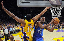Mark J. Terrill  |  The Associated Press Oklahoma City forward Kevin Durant, right, goes up for a shot as Los Angeles center Andrew Bynum defends during Game 4 of the Western Conference semifinals on May 19.