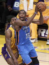 Oklahoma City Thunder's Kevin Durant, right, looks to shoot as he is defended by Los Angeles Lakers' Metta World Peace during the second half in Game 3 of an NBA basketball playoffs Western Conference semifinal in Los Angeles, Friday, May 18, 2012. (AP Photo/Jae C. Hong)
