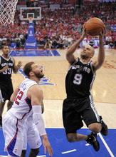 San Antonio Spurs guard Tony Parker of France, right, puts up a shot as Los Angeles Clippers forward Blake Griffin defends during the first half in Game 4 of an NBA basketball playoffs Western Conference semifinal, Sunday, May 20, 2012, in Los Angeles. (AP Photo/Mark J. Terrill)