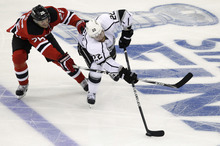 New Jersey Devils' Patrik Elias, left, of the Czech Republic, chases Los Angeles Kings' Trevor Lewis during the second period of Game 1 of the NHL hockey Stanley Cup finals Wednesday, May 30, 2012, in Newark, N.J. (AP Photo/Kathy Willens)