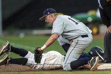 Chris Detrick  |  The Salt Lake Tribune Timpanogos' Jordan Evans (5) dives safely back to first base past Skyline's Mike Staes (10) during the 4A championship game at Kearns High School Friday May 25, 2012.