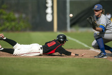 Chris Detrick  |  The Salt Lake Tribune American Fork's Zac Haws (10) dives safely back to first bast past Taylorsville's Jackson Roper (32) during the 5A championship game at Kearns High School Friday May 25, 2012.  American Fork won the game 5-4.