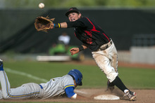 Chris Detrick  |  The Salt Lake Tribune American Fork's Jake Miles (23) can't make a catch as Taylorsville's Mark Lesuma (17) dives safely back to first base during the 5A championship game at Kearns High School Friday May 25, 2012.  American Fork won the game 5-4.