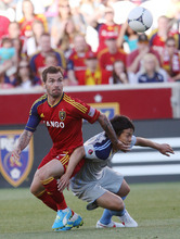Steve Griffin | The Salt Lake Tribune Real Salt Lake's Jonny Steele fights past Minnesota's Kentaro Takada as he battles for the ball during first-half action at Rio TInto Stadium in Sandy on May 29, 2012.