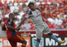 Steve Griffin | The Salt Lake Tribune Real Salt Lake's Jamison Olave, left, heads the ball away from  Minnesota's Amani Walker during first-half action at Rio TInto Stadium in Sandy on May 29, 2012.