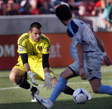 Steve Griffin | The Salt Lake Tribune  Real Salt Lake goal keeper Kyle Reynish stops a Minnesota shot during first-half action at Rio Tinto Stadium in Sandy on May, 29, 2012.