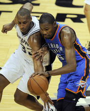 San Antonio Spurs power forward Boris Diaw, left, of France, and Oklahoma City Thunder small forward Kevin Durant (35) go after a loose ball during the second half of Game 2 in their NBA basketball Western Conference finals playoff series, Tuesday, May 29, 2012, in San Antonio. The Spurs won 120-111. (AP Photo/Darren Abate)