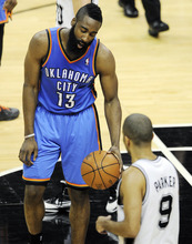 Oklahoma City Thunder guard James Harden (13) reacts as San Antonio Spurs point guard Tony Parker (9), of France, takes the ball downcourt after a play during the second half of Game 1 in their NBA basketball Western Conference finals playoff series, Sunday, May 27, 2012, in San Antonio. San Antonio won 101-98. (AP Photo/Darren Abate)